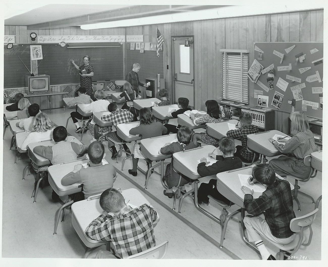 This advertisement for the Glenwood Inglewood Water Company from the 1950's shows a modern classroom with a television and, more importantly, a water cooler.